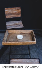 empty chairs in a street cafe with ashtray on table