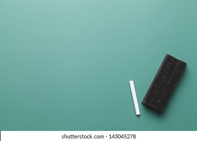 Empty Chalk Board with Copy Space, Chalk and Eraser.