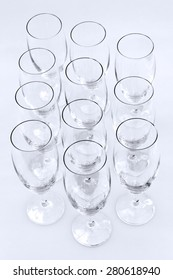 Empty champagne glasses from above on light background