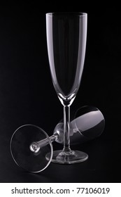 empty champagne glasses on black background