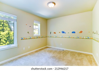 Empty cheerful kids room with painted walls