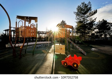 Empty Children kid playground for leisure and recreation activity with toy in the park in childhood color style and tree with sunlight background.Urban neighborhood childhood concept.
