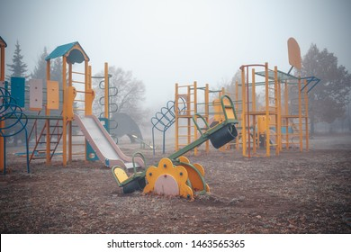 Empty children's playground on a foggy autumn morning.