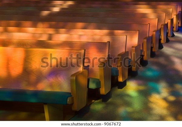 Empty church pews with Heavenly Light.