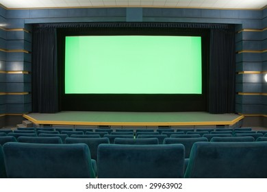 Empty cinema auditorium with line of blue chairs and projection screen. Ready for adding your own picture.
