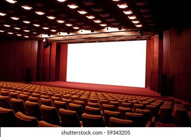 Empty cinema auditorium. Projection screen is ready for adding a picture