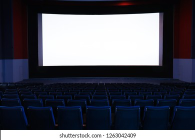 Empty cinema with large screen and comfortable chairs. Space for text