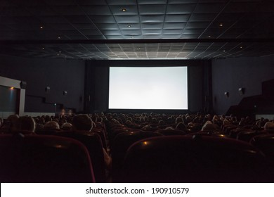 Empty cinema screen with audience. Ready for adding your picture.