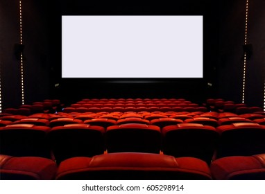 Empty cinema seats with blank white screen