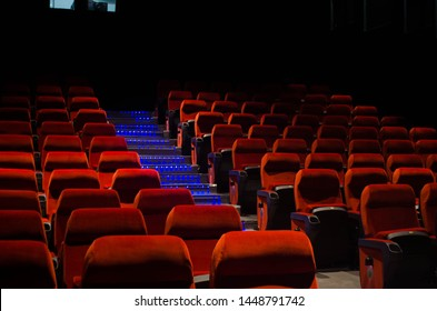 empty Cinema theatre hall with red comfortable chair