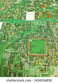 Empty circuit board, pcb printed computer technology and design pattern. Green pcb have screen charactor on pcb. Close up.