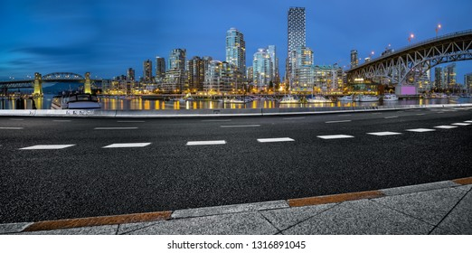 empty city road go through downtown, vancouver,canada.