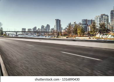 empty city road with skyline background, vancouver, canada.
