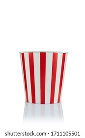 empty classic red and white paper striped bucket for popcorn isolated over the white background.