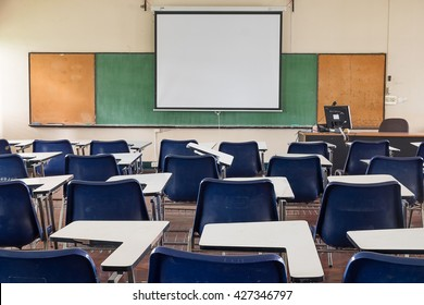 Empty classroom with chairs, desks