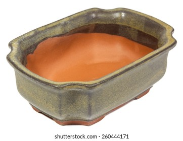 Empty clay bonsai pot isolated on white background.