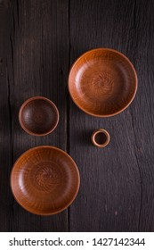 Empty clay bowls on a wooden table. Top view. Concept: food.