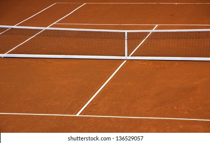 Empty clay tennis court during game time-out