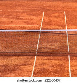 Empty Clay Tennis Court and Net.