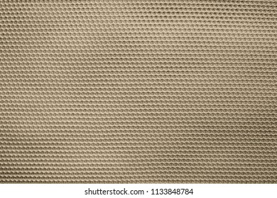 empty and clean background or wallpaper with abstract mesh texture of fabric or textile material a closeup of sepia color