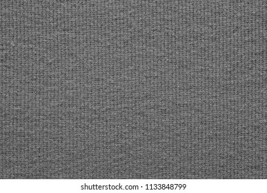 empty and clean background or wallpaper with abstract knitted texture of fabric or textile material a closeup of gray color