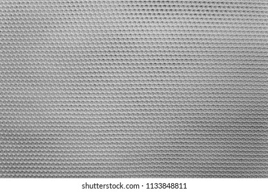 empty and clean background or wallpaper with abstract mesh texture of fabric or textile material a closeup of gray color