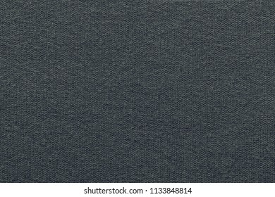 empty and clean background or wallpaper with abstract knitted texture of fabric or textile material a closeup of dark gray color