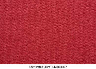 empty and clean background or wallpaper with abstract knitted texture of fabric or textile material a closeup of red color