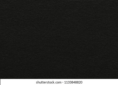 empty and clean background or wallpaper with abstract knitted texture of fabric or textile material a closeup of black color