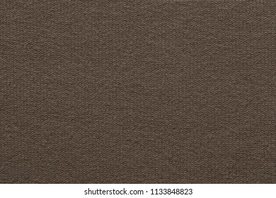 empty and clean background or wallpaper with abstract knitted texture of fabric or textile material a closeup of dark brown color