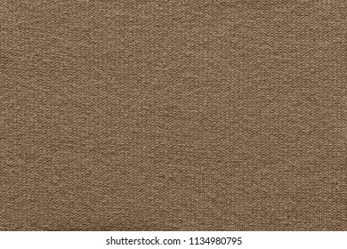 empty and clean background or wallpaper with abstract knitted texture of fabric or textile material a closeup of light brown color
