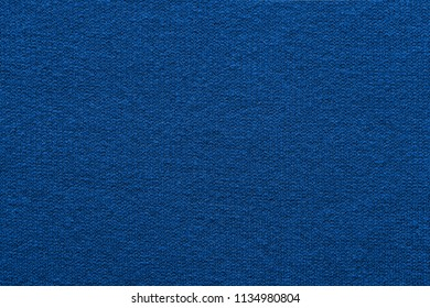 empty and clean background or wallpaper with abstract knitted texture of fabric or textile material a closeup of blue color