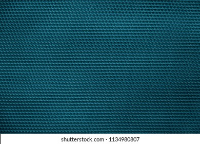 empty and clean background or wallpaper with abstract mesh texture of fabric or textile material a closeup of blue color