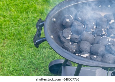 Empty And Clean BBQ Grill Pit With Hot Charcoal Briquettes. Concept For Outdoor Barbecue Party Or Picnic Or Cookout.