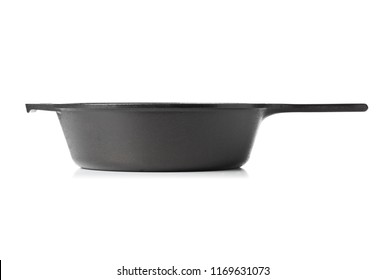 Empty, clean black cast iron pan or dutch oven side view over white background