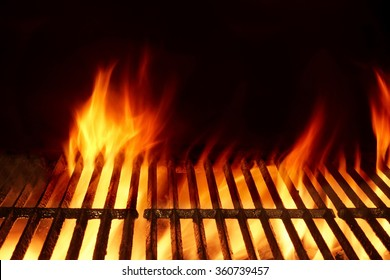 Empty Clean Flaming Barbecue Grill Isolated On Black Background. Top View. Summer Party or Cookout Or Picnic Concept