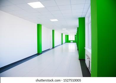 Empty clean hallway or corridor of interior classroom with furniture cabinet and door room at school