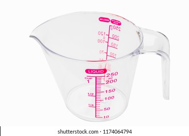 Empty Clear Color Plastic Graduated Measuring Cup or measuring jug  on white background