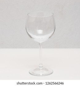 Empty Clear Wine Glass at White Background