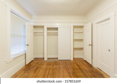 An empty closet in an empty studio apartment