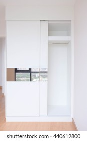 Empty closet, working closet, cupboard in bedroom. Built-in wardrobe in a compact size. Living in apartment concept