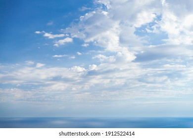 Empty coastal landscape with calm blue sea water under dramatic cloudy sky