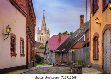 Empty cobblestone streets and church tower in the small town of Cesis, Latvia