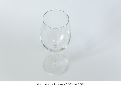 an empty cocktail glass for white wine on a white background