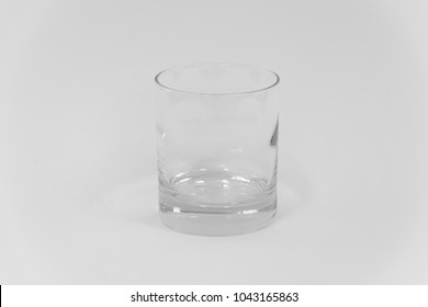 An empty cocktail old fashion glass on a white background