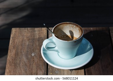 Empty coffee cup after drink on wood table,dramatic