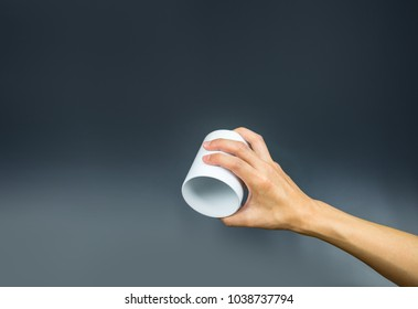 Empty coffee cup, hand holding upside down