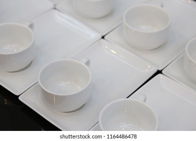 empty coffee cup on white dish