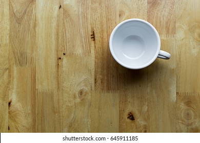Empty coffee cup on wooden table.