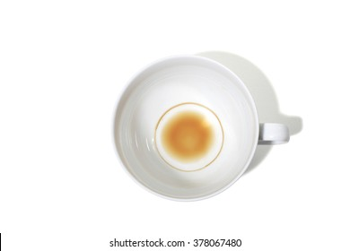 Empty Coffee Cup with Coffee Stain Inside on a White Background